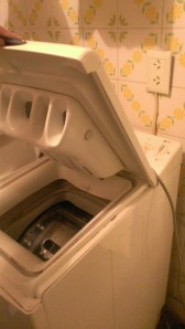This is our washing machine. It will try to electrocute you if you forget to UNPLUG it before opening it. It would have been awesome if the landlord had told us that BEFORE we tried to use it.